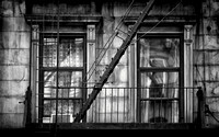 "9th, Avenue, B*W, NYC, Street, W56th, cityscape, ""fire escape stairs"", rust, structure, building, windows, wires, curtains, ""urban decay"""
